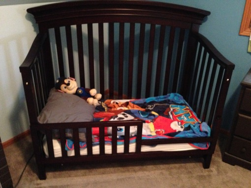 Crib turned toddler bed turned PAW Patrol hangout.